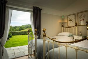 A romantic, country bedroom overlooking the garden