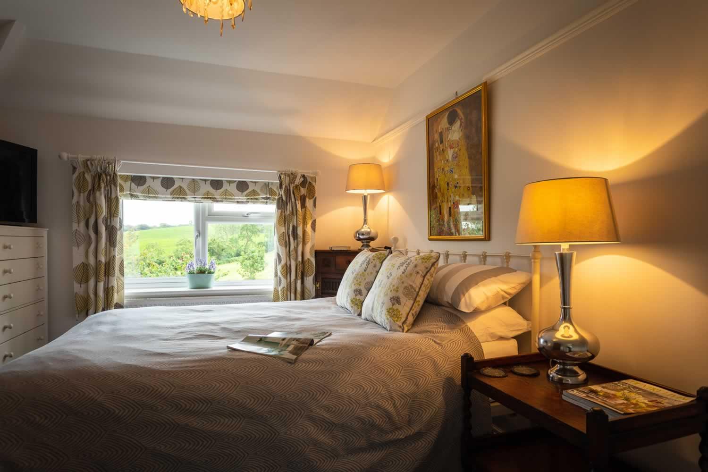 King size bed in master bedroom with en-suite
