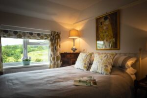 King size bed with views across garden and fields