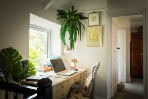 Comfortable desk space overlooking driveway, perfect for essential emails