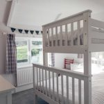 Triple sleeper bedroom on first floor, designed with children in mind