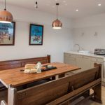 Large kitchen diner featuring mood lighting for enhancing mealtimes