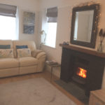 Sitting room with cosy log burner